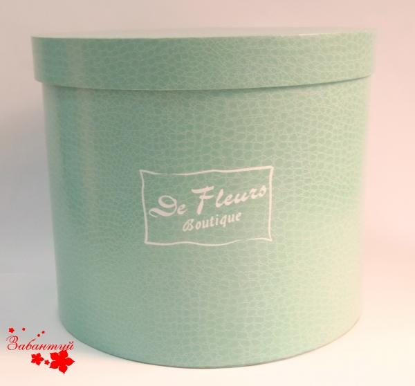 Круглая коробка для цветов. Сделана из итальянсой бумаги «под кожу»