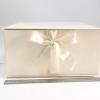 Розмір 35х35х16 см. Коробка з стрічках. Колір бежевий
