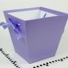 Коробка в форме трапеции. Внизу 17х17, вверху 26х26 см. Высота 25 см. Цвет фиолетовый