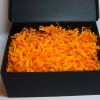 Наполнитель в подарочные коробки. Объем в распушенном виде 1,5 литра. Цвет: оранжевый № 581