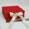 Розмір 12х12х4 см. Коробка з стрічках. Колір червоний
