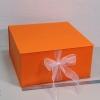 Розмір 35х35х16 см. Коробка з стрічках. Колір помаранчевий